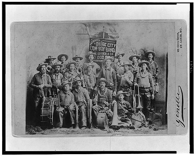 [Dodge City Cow-Boy Band with their instruments]