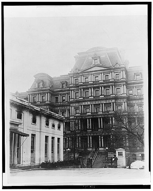 The State, War and Navy Bldg. showing the damaged Executive Offices - the President's office is directly over the entrance to the 2nd floor