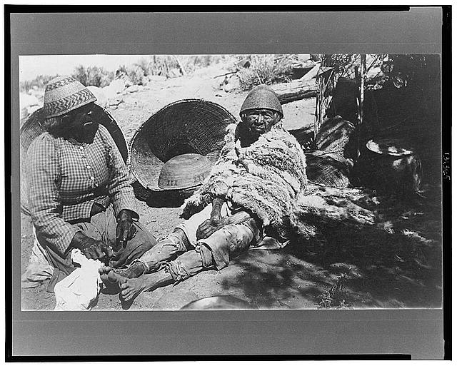 [Two old Paiute Indian women with baskets and woven hats, one identified as Teha]