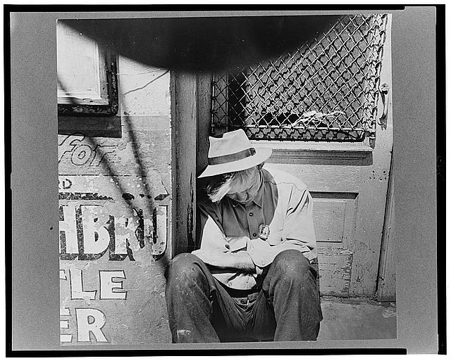 New Orleans, Louisiana. Man sleeping in a doorway