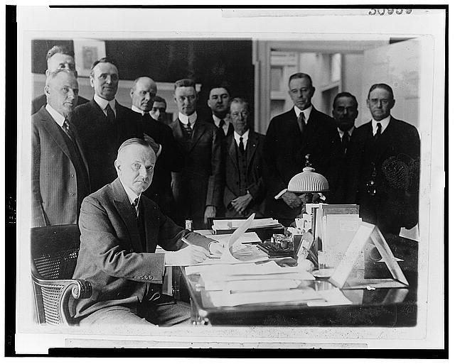 President Coolidge signing the Cameron Bill which authorizes the construction of the Coolidge Dam in Arizona