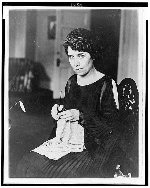 [Grace Coolidge, half-length portrait, seated, knitting, facing left]
