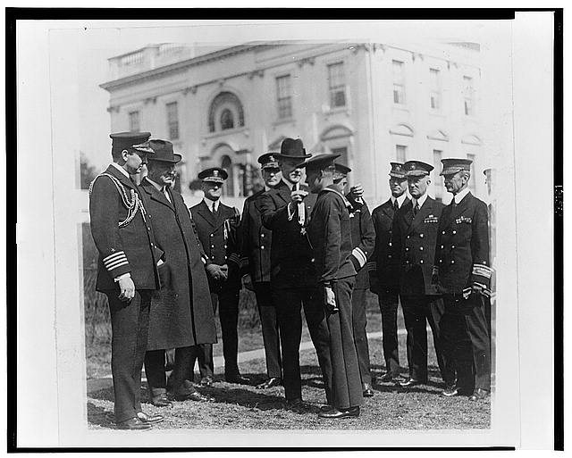 [President Coolidge] decorating Henry Breault of the submarine 0-5 with Congressional Medal of Honor