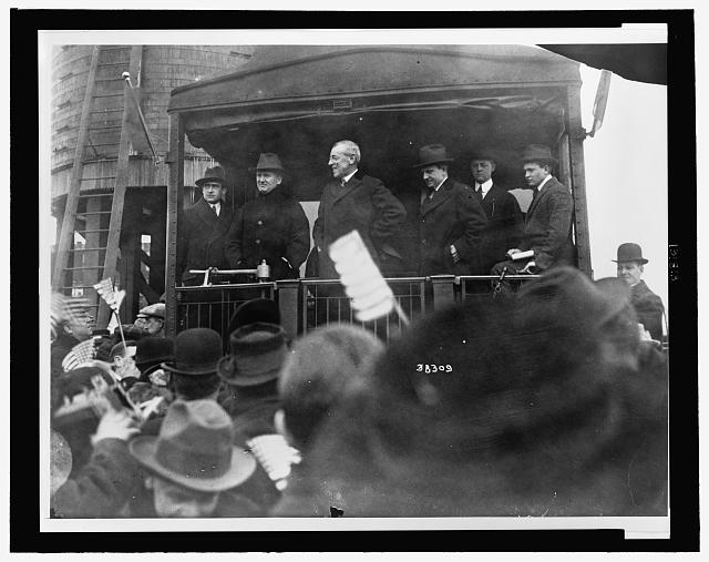 [President Woodrow Wilson speaking to a crowd from the back of a train, January, 1916]