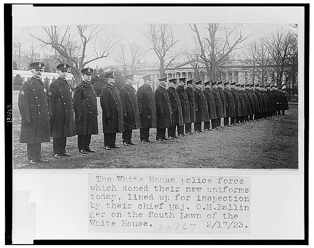 The White House police force which doned [sic] their new uniforms today, lined up for inspection by their chief Maj. O.M. Ballinger on the south lawn of the White House