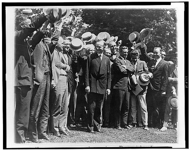 Newspapermen cheering President Coolidge after their first conference with him at the White House