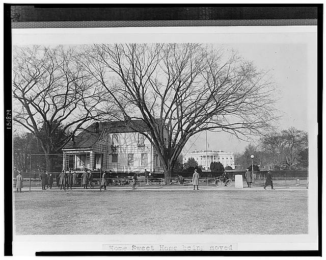 Home sweet home being moved to its permanent location, passing the south grounds of the White House