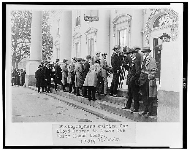 Photographers waiting for Lloyd George to leave the White House today
