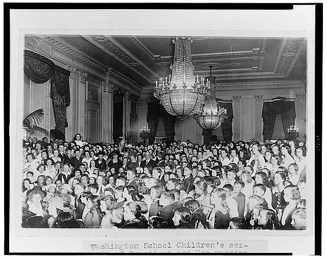 Washington school childrens' serenade of President and Mrs. Harding, as a feature of the Music Week program, which was to have been held at the Lincoln Memorial, was transferred to the East Room of the White House because of the rain