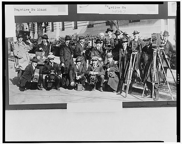 [Group portrait of seventeen members of the White House News Photographers' Association, standing and squatting, facing front, with cameras]