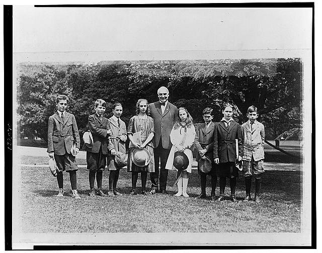 With members of the nature study class of John Buroughs [sic] School whom he invited to the White House to see an owls nest in the grounds