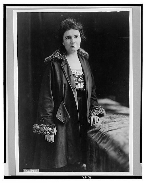 [Miss Anne Martin, three-quarter length portrait, standing, facing front, wearing coat]