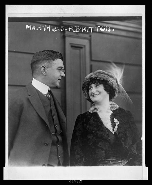 [Mrs. Schuyler Britton, owner of the St. Louis Cardinals, and her husband, half-length, conversing]