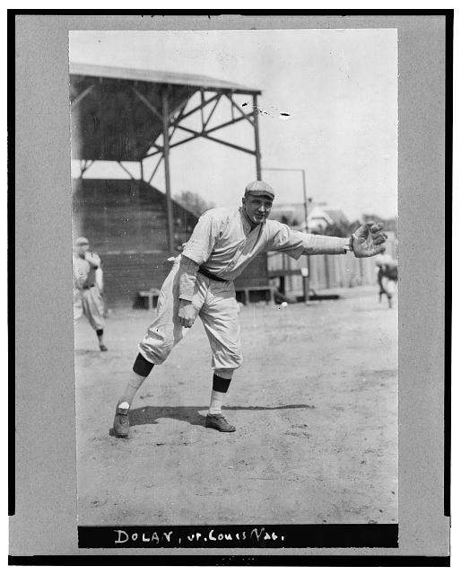 "[Alvin, i.e., Albert James ""Cozy"" Dolan, St. Louis Cardinals baseball player, facing front, standing, wearing uniform, in position to catch thrown baseball]"