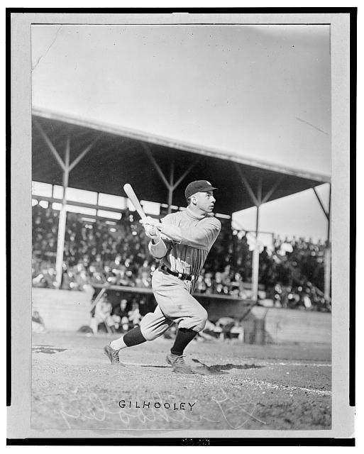 [Frank Gilhooley, baseball player with the New York Yankees, swings his bat at home plate]