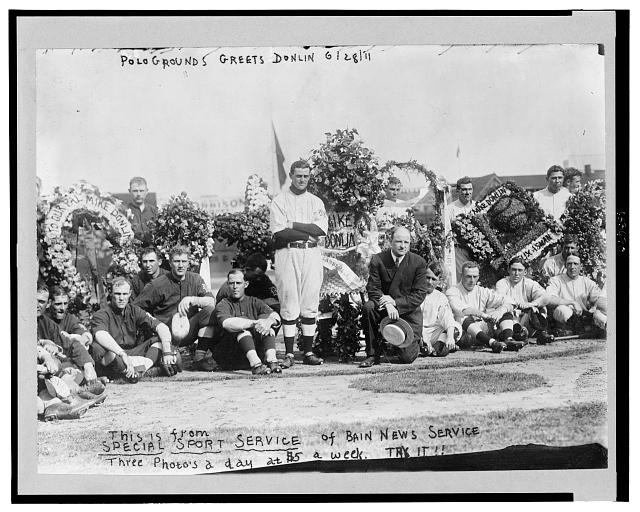 "[""Turkey"" Mike Donlin, baseball player for the New York Giants, standing, (center) is celebrated by the members of his team and manager John McGraw, kneeling (center)]"