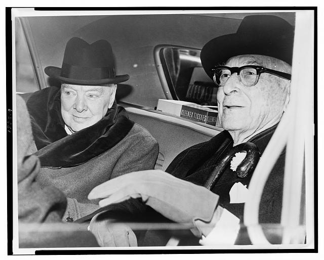 Churchill & Baruch talk in car in front of Baruch's home