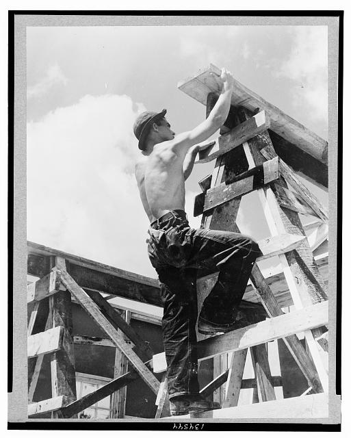 Work projects: Enrollee William L. Cross, Appalachia, Va., climbing up on scaffold erected for assembling a prefabricated building which is to be a camp work shop