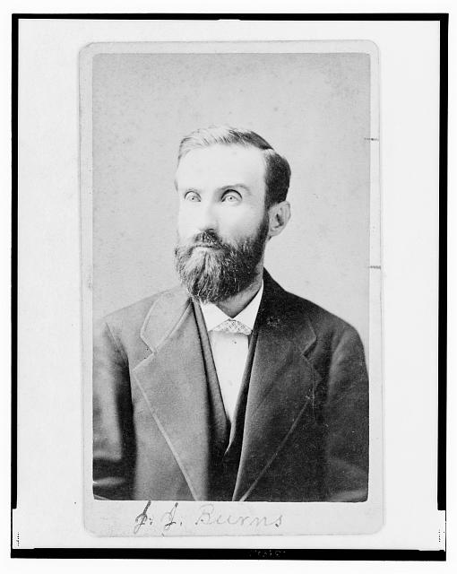 [John J. Burns, half-length portrait, facing left]