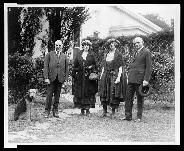 "[Warren Harding with pet dog Laddie Boy in the yard at the White House, with ""Pop"" Anson and his daughters]"