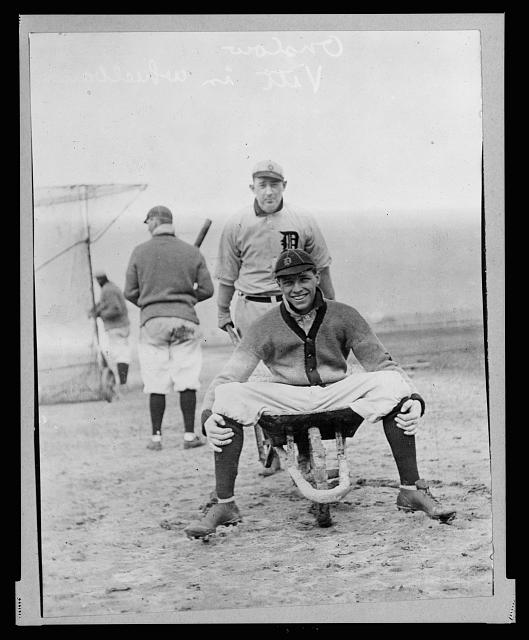 [Tiger Jack Onslow pushes wheelbarrow containing Ossie Vitt, 3/20/1912 (baseball)]