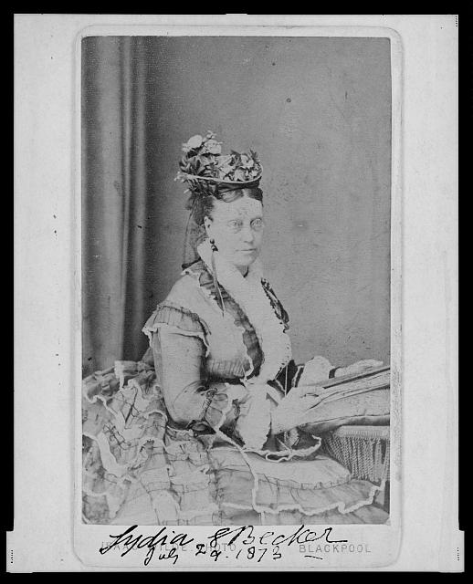 [Lydia E. Becker, three-quarter length portrait, seated facing right]