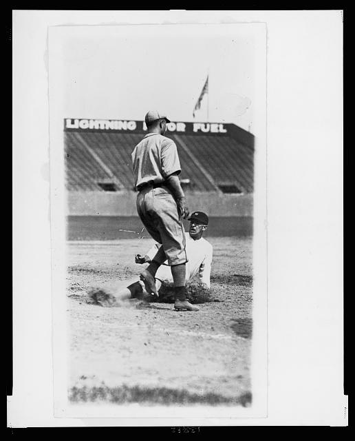 Bucky Harris, safe at third, Phila.- Wash. ball game