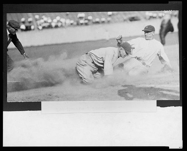 [Joe Harris, of the Washington National, sliding safely into 3rd base during a baseball game]
