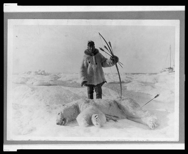 Eskimo hunter and polar bear slain with bow and arrow