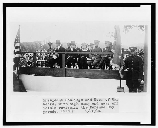 President Coolidge and Sec. of War Weeks, with high Army and Navy officials reviewing the Defense Day parade