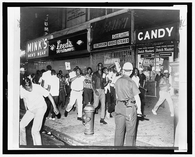 The fatal shooting of Powell stirred Negro rioters to race through Harlem streets carrying pictures of Lt. Gilligan