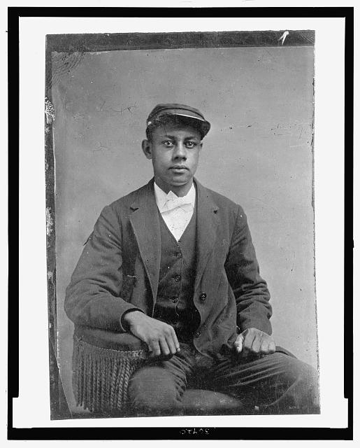 [Portrait of African American man, seated]