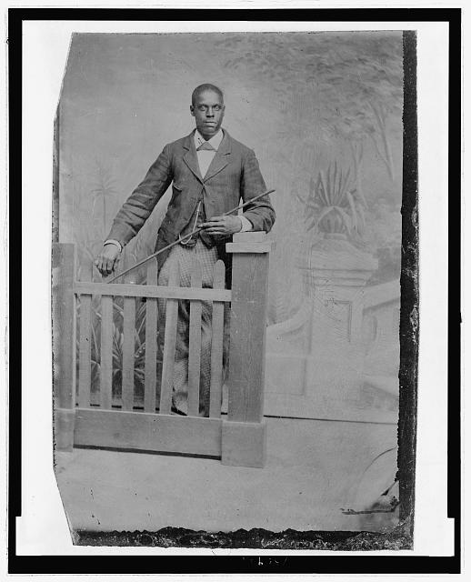[Portrait of an African American man, standing]