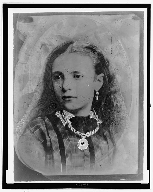 [Unidentified girl in a plaid dress with lace collar and jewelry]