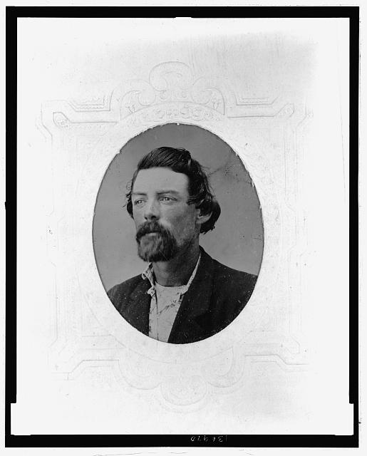 [Three-quarter face portrait of man with beard]