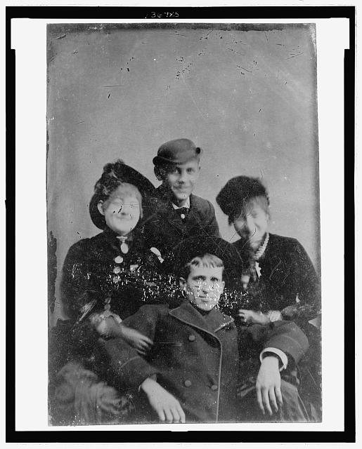 [Group portrait of a two men and two women, possibly a family]