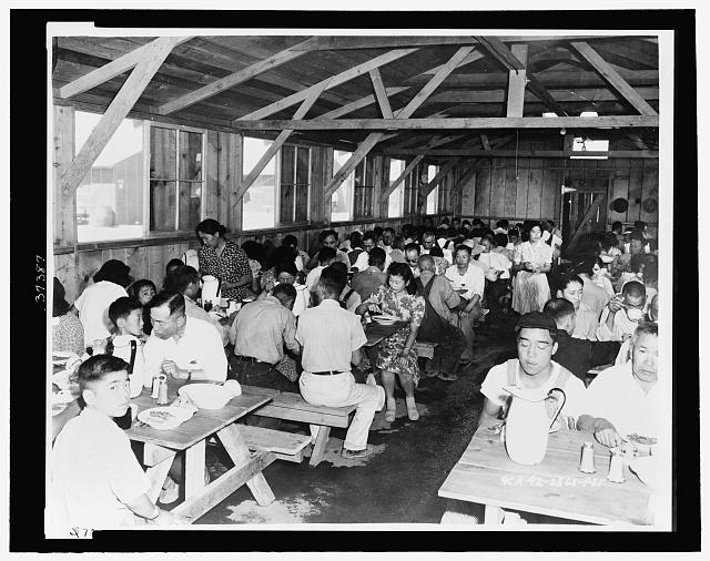 Pinedale (Calif.) Assembly Center - Evacuees enjoying a hearty meal in Center dining hall