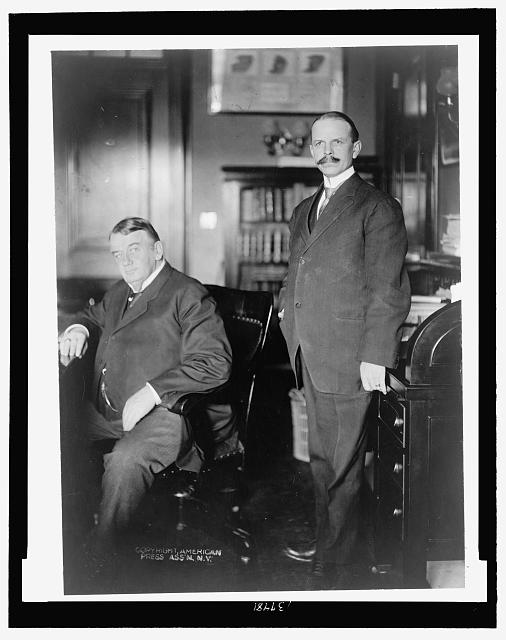 [Weldon B. Heyburn (seated), Republican representative from Idaho, with secretary H. B. Smith (standing) ]