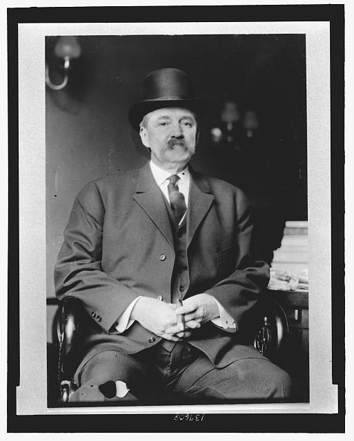 [Albert Baird Cummins, Senator from Iowa, three-quarter length portrait, seated, wearing hat, holding cigar]