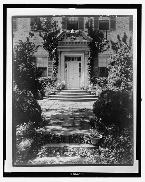 "[""Chatham,"" Colonel Daniel Bradford Devore house, 120 Chatham Lane, Fredericksburg, Stafford County, Virginia. West entrance, with small dog sitting on steps at door]"