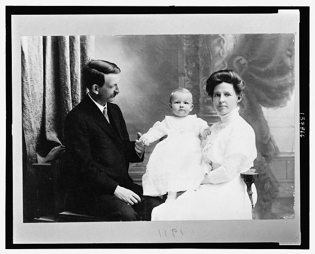 [Family portrait of Grace Whiting holding son Spafford, with her husband John D. Whiting]