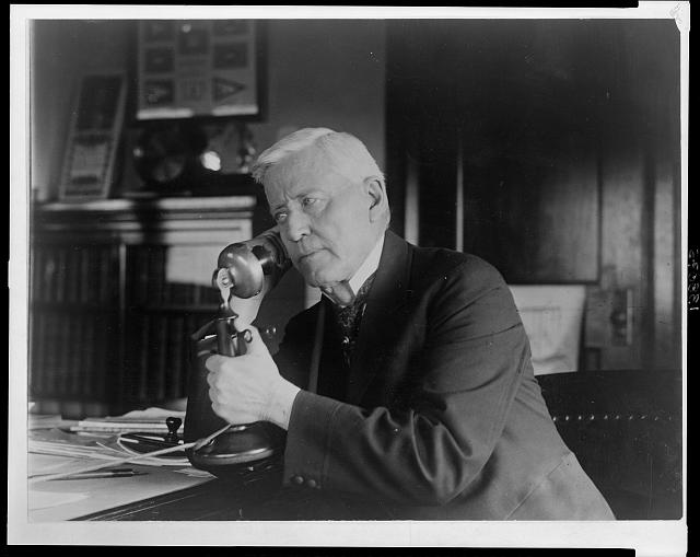 [Joshua W. Alexander, Democrat Congressman from Missouri, half-length portrait, seated with candlestick telephone in hand]