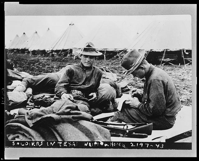 Soldiers in Texas writing home. Apr. 24, 1914