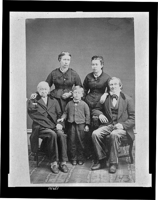 [Lomer Griffin, seated (left) with members of his family]