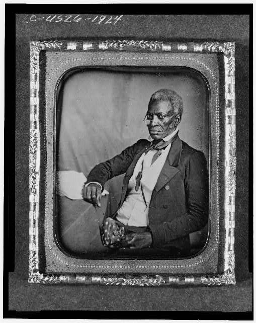 [John Hanson, three-quarter length portrait, three-quarters view, wearing glasses, seated at desk]