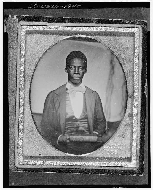 [Edward Wilmot Blyden, half-length portrait, facing front, holding book]