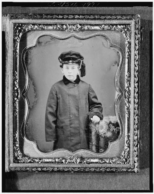 [George Leverett Stowell as a boy, three-quarter length portrait, standing, full face, with hand on table with tablecloth]