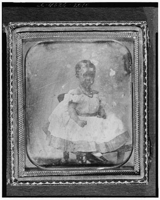 [Mabel Hubbard as a girl, full-length portrait, seated on chair]