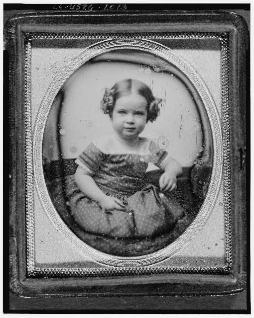[Mabel Hubbard, half-length portrait of a girl, facing front, seated]