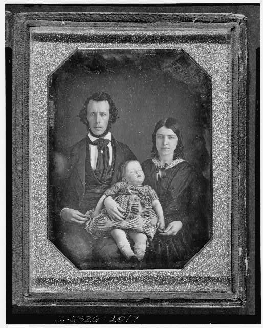 [Adams family portrait, with man, woman, and baby girl]